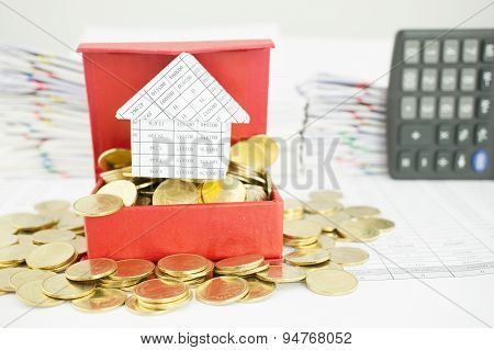 Close Up House On Gold Coin In Red Box