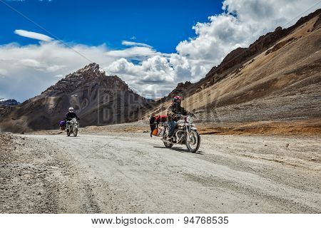 LADAKH, INDIA - SEPTEMBER 2, 2011: Bike tourists in Himalayas on famous high altitude Leh-Manali Highway. Himalayan bike tourism is gaining popularity for tourists and bikers from all over the world