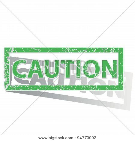 Green outlined CAUTION stamp
