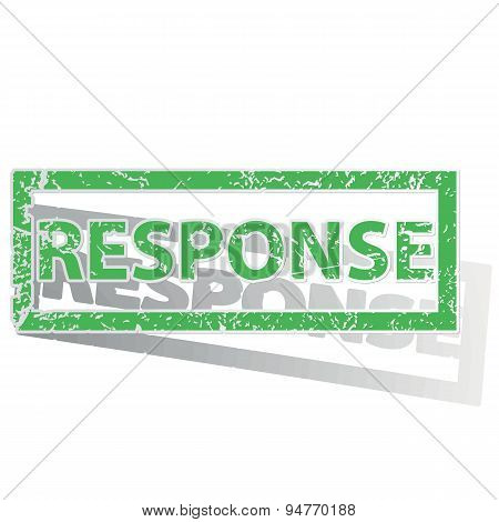 Green outlined RESPONSE stamp