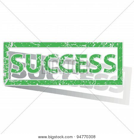 Green outlined SUCCESS stamp
