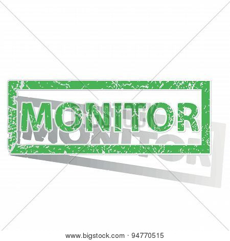 Green outlined MONITOR stamp