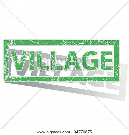 Green outlined VILLAGE stamp