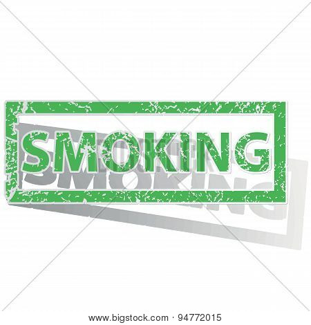 Green outlined SMOKING stamp