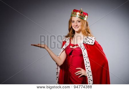 Pretty young queen in red dress isolated on white