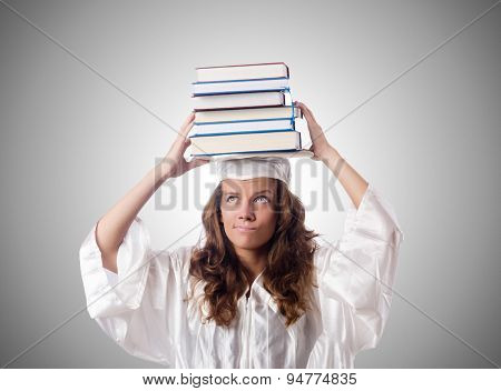 Graduate with book against the gradient