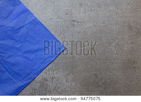 Background From Gray Stone With Triangle Of Blue Paper