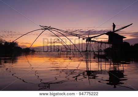 Fisherman Silhouette With Net