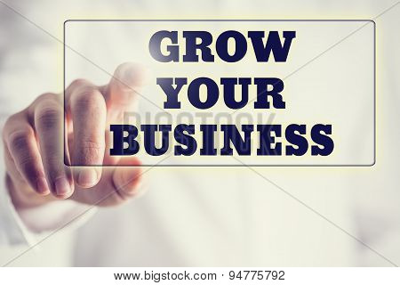 Concept Of New Or Start Up Business - Words Grow Your Business On A Virtual Interface