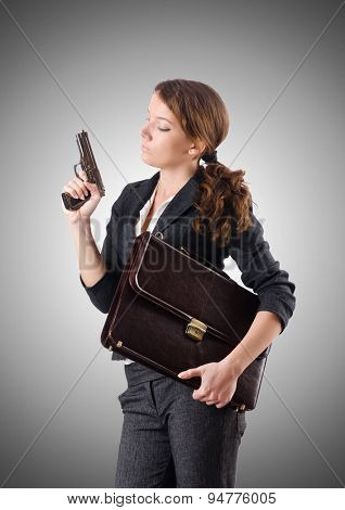 Woman businewoman with hand gun
