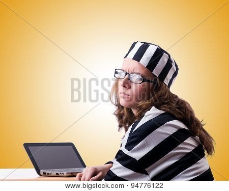Criminal hacker with laptop against gradient