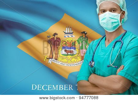 Surgeon With Us States Flags On Background Series - Delaware