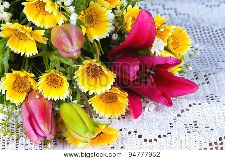 Summer flowers on a white tablecloth