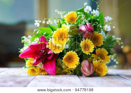 Flowers on the wooden table