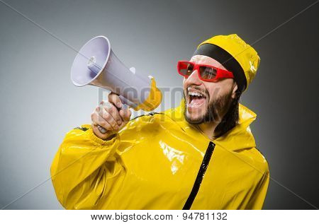 Man wearing yellow suit with loudspeaker