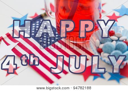 happy american independence day, celebration, patriotism and holidays concept - close up of juice glass, flag and candies at 4th july party