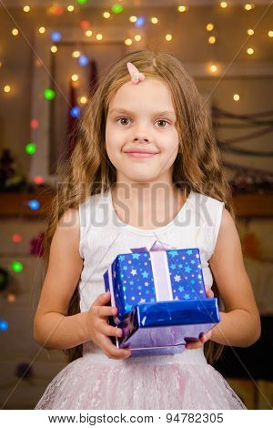 Five-year Girl With Christmas Gifts In His Hands