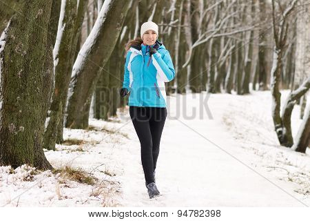 Young Woman Jogging In Winter Park