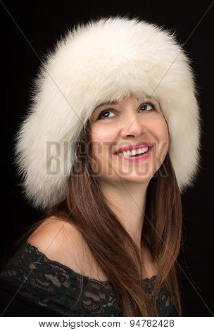 Cheerful Fashion Girl Wears White Fur Hat