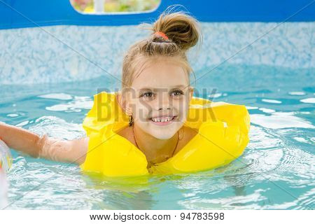 Cheerful Girl Swimming In Pool Swimming Vest