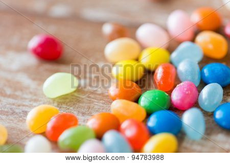 food, junk-food, confectionery and unhealthy eating concept - close up of multicolored jelly beans candies on table