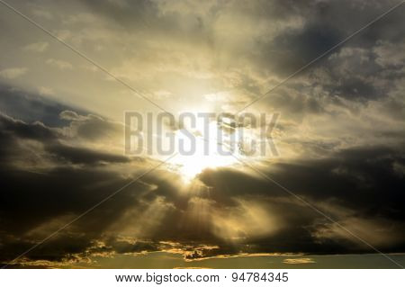 Sun Through The Stormy Clouds. Natural Background