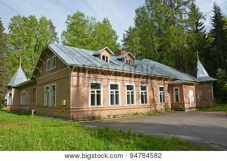 Vintage Style Wooden House At Spring Season