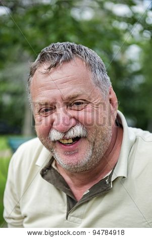 Mature mustached man in the park