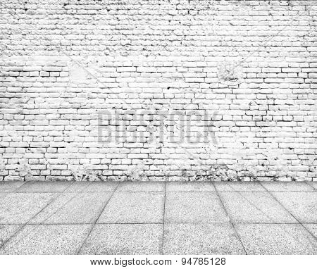 Wall made of bricks and floor from stone