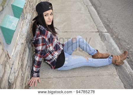 teen siting on the ground like depressed