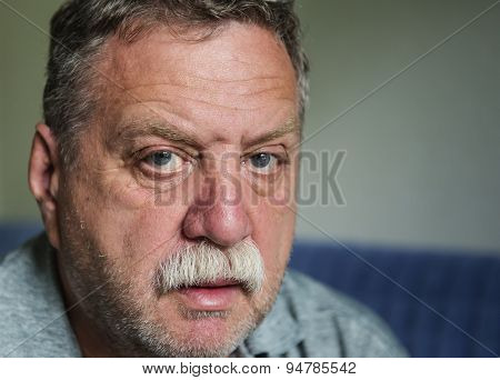 Thoughtful mature man portrait