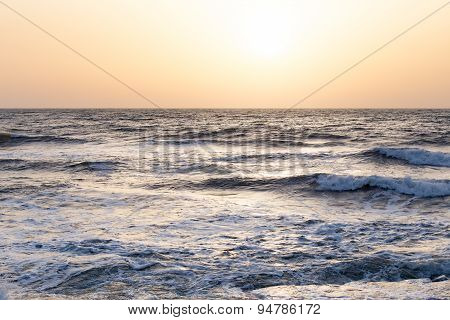Sunset sunrise on the sea with beautiful waves