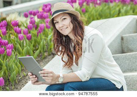 Urban woman sitting with tablet computer on stairs