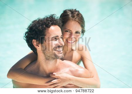 Young couple having fun in the water
