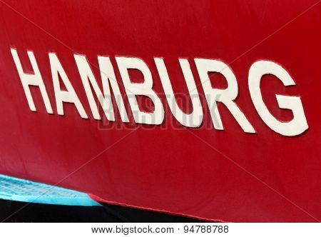 Hamburg, white signage on red ship closeup