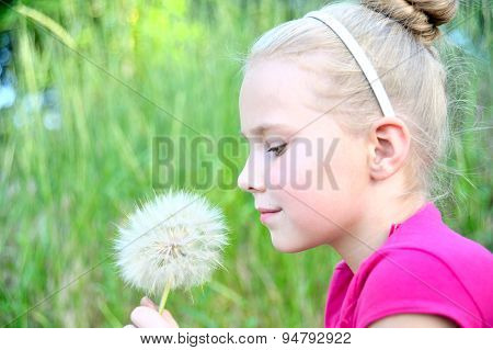 Portrait of a girl with dandelion