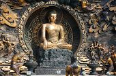 stock photo of buddhist  - Statues of Buddhist followers praying to Buddha at Lingshan Grand Buddha scenic area in Wuxi China - JPG