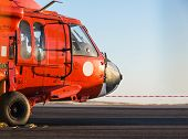 pic of military helicopter  - Orange military helicopter at the airport closeup - JPG