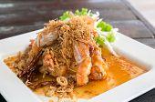 stock photo of tamarind  - Deep fried shrimp platter with tamarind sauce - JPG