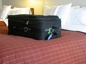 stock photo of goodnight  - luggage in the beds of a hotel room - JPG