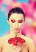 pic of lillies  - Young woman with red lilly flower - JPG