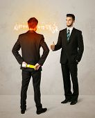 image of backstabbers  - Angry businessman hiding a weapon behind his back  - JPG