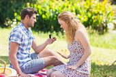 foto of propose  - Young man propose to girlfriend on a sunny day - JPG