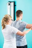 stock photo of physical therapist  - Patient at the physiotherapy doing physical exercises with Bowden cable  - JPG