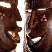 picture of african mask  - african wooden masks on the wall of online shop - JPG