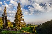 picture of mountain chain  - Mountain scenery with Almaty city view at blue sky in Kazakhstan - JPG