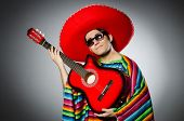 picture of sombrero  - Man in red sombrero playing guitar - JPG