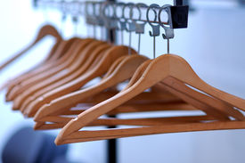image of clothes hanger  - empty clothes hangers lined up in a room - JPG