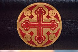 stock photo of celtic  - Red and gold decorative celtic cross engraved on the spine of an old leather book - JPG