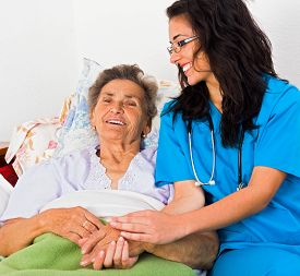 pic of nursing  - Kind nurse easing elderly lady - JPG